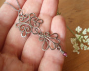 AJB dusky lace pendant in hand